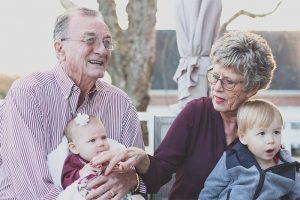 grandparents with their grandchildren after winning custody