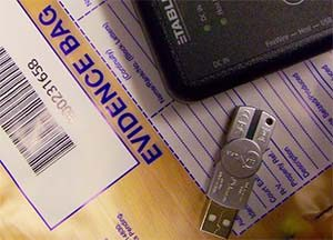 usb drive being collected as evidence in divorce case